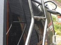 Chrome ladder for Mitsubishi Delica L300. Mounts on