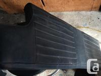 This is a black leather rear bench seat cushion for a