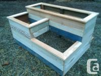 Rustic planter boxes built from reclaimed wood, mostly