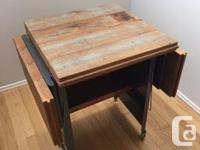 Side table made from reclaimed floorboards. Leaves drop