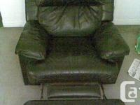 - A Very comfy Recliner chair with foot rest. - With