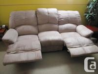 Recliner couch in excellent condition 1 year old backs