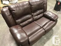GUC leather loveseat. Dual recliners. Overall 9/10.