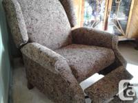 Comfy yet firm reclining arm chair. Very new condition;