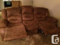 1 Brown microfiber double reclining couch. The backs on