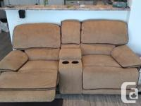 Very good condition, fully reclining sofa. Two drink