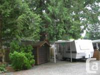In forested Harrison Holiday Park, in Harrison Hot
