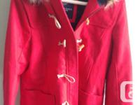 Brand new, with tags still attached. I love this coat -