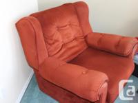 An extremely comfortable red velour chair in good