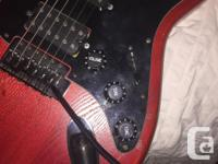 Hand crafter guitar that has a whammy bar, It has full
