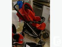 Stroller is a red and black Peg Perrego Pliko Switch