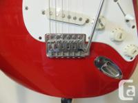 Sharp looking MIM Red Strat with white pick guard and