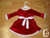 I have a Red Velvet Santa Dress and Pants Set Size 18