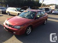 Make Mazda Year 2001 Colour Maroon over Black Leather