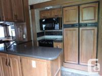 2012 Montana 3400RL 4 slides, Double door fridge,