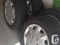 Like new - 4 Dunlop Graspic DC3 winter tires on 15 inch