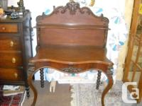 The detailing on this antique mahogany table is supurb.