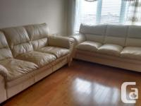 I am offering my two real leather sofas purchased at