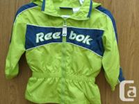 Boys green Ree-bok jacket with Hoodie, the jacket is