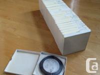 32 reel-to-reel tapes in large-hub CINE reels. Most of
