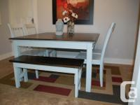 Beautifully refinished dining table with a leaf making