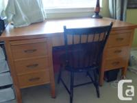 In excellent condition, with brass feet, this desk has