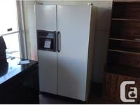 Hotpoint side by side refrigerator with ice dispenser.