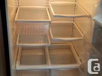Frigidaire steel fridge for sale. Interior looks very