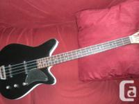 Custom Bass by Dave Reimer Looks like Danelectro, but