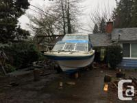 24' Reinell Cabin cruiser on great trailer. The boat
