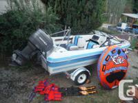 17 ft  Reinell with 135 Mariner Outboard - trailer -