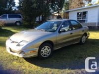 Make Pontiac Model Sunfire Year 2003 Colour Gold kms