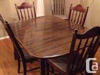 "Dining room set for sale. Table 57"" x 42"" and it has a"