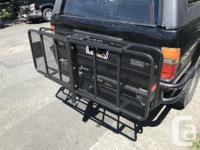 """Steel frame 2"""" trailer hitch cargo carrier for rent."""
