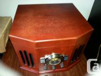 THIS RETRO STYLE AM/FM/CASSETTE/C.D/AND RECORD