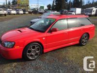 Make Subaru Model Legacy Wagon Year 2001 Colour Red