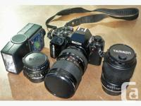 Complete set of camera, flash, and three lenses. All