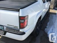 Make Honda Model Ridgeline Year 2012 Colour White, kms