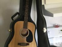 Jasmine guitar by Takamine with hard shell carry case