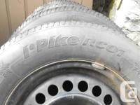 Set of 4 rims with Hankook snow tires mounted on GM