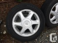 Set of Nissan alloys with summer tires installed. These