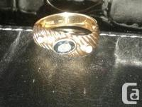 I have a size 6 1/2 14k gold sapphire ring with 2 small