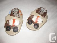 I am selling a pair of gently used Robeez slippers,