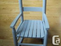 One pint-sized wooden rocking chair for sale. Children