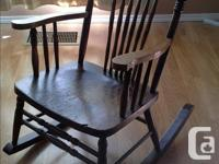 Antique, solid wood, pressback rocking chair in very
