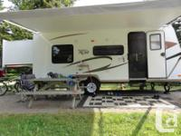 Rear hard-slideout with queen bed. Front has lower