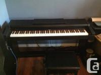 Roland HP-1500 electronic piano and bench available.