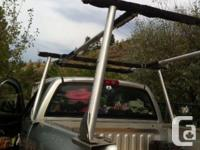 Aluminum heavy duty roof rack fits over the canopy and