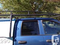 Adjustable roof rack  fits most short box trucks. Great