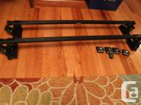 A pair of roofing system racks for holding Thule box,